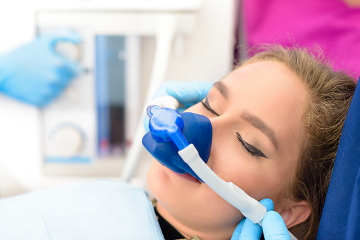 A patient receiving nitrous oxide for a procedure at Fern Creek Dentistry in Statesville, NC